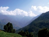 Foothill of Annapurna, cross the valleys seen from Pothana.jpg